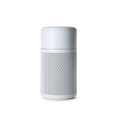 Small white air purifier on white background