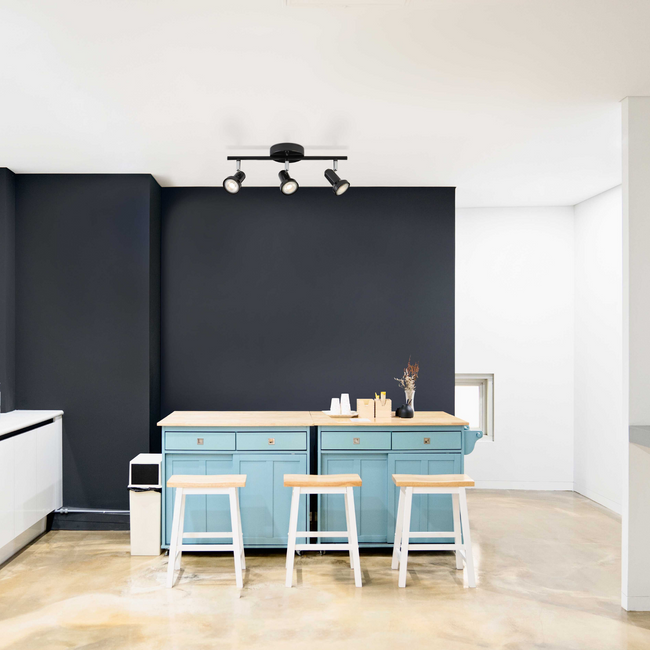 Black 3-light Bay track light mounted on a white ceiling in a kitchen setting – teal  island