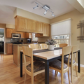 Brown and Tan Kitchen/Living space with the Herly Track Lighting Kit hanging above