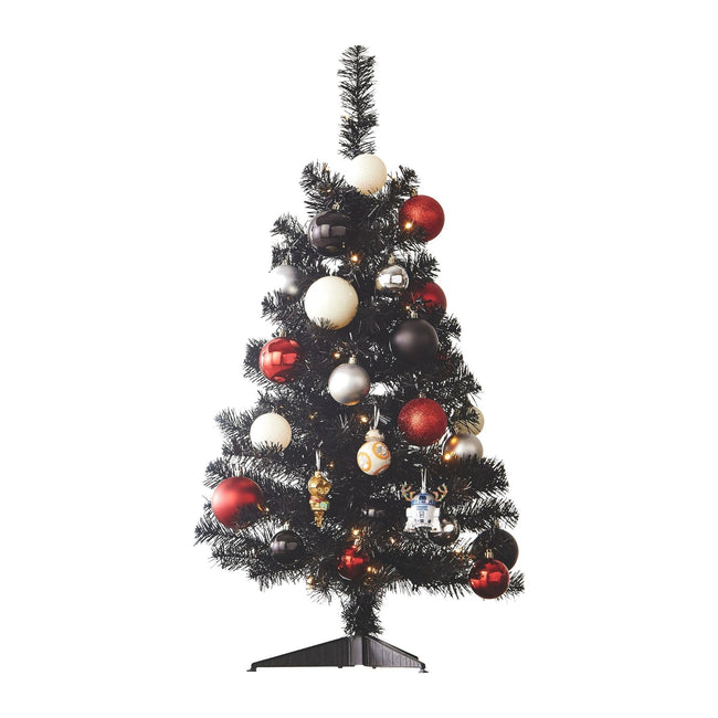 Black Table Top Tree Decorated with Red & White Christmas Ornaments and Baubles. White Background
