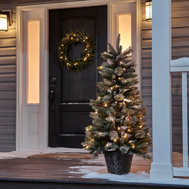 NOMA 4 Ft Snow Dusted Jackson Christmas Tree on Porch. Wreath on Door. Snow on Floor of Porch