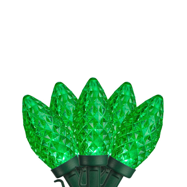 NOMA Green C9 String Light Bulbs Fanned Out on White Background