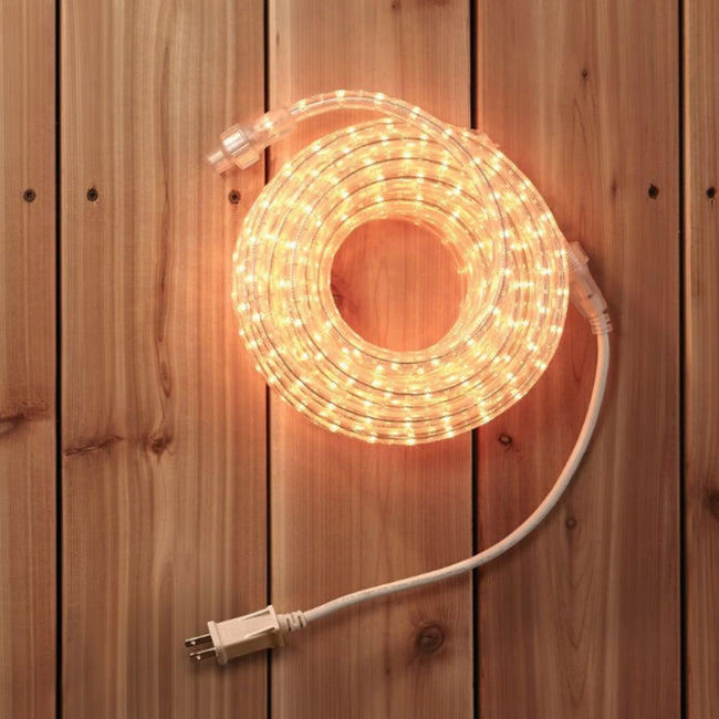 NOMA 30 Ft Flexible Incandescent Rope Light -Warm White, Coiled on Wooden Floor