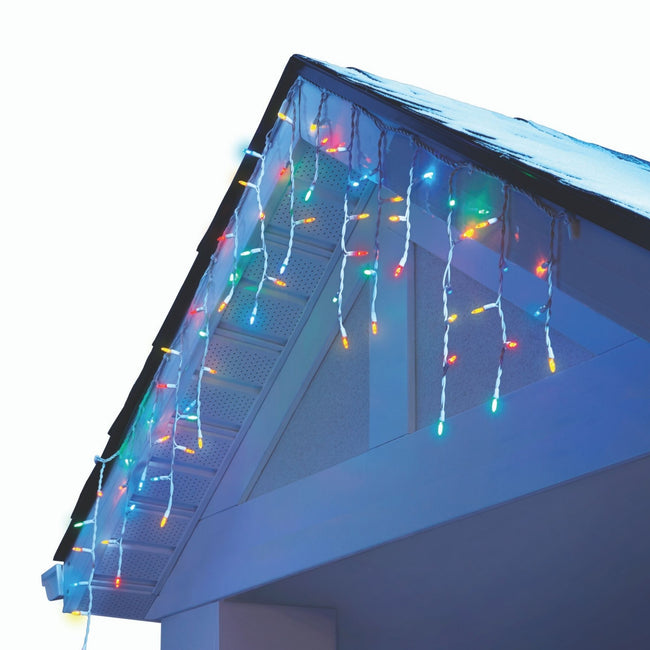 NOMA Mini Icicle Multi-Color String Lights Displayed Hanging from Roof Edge on White Background