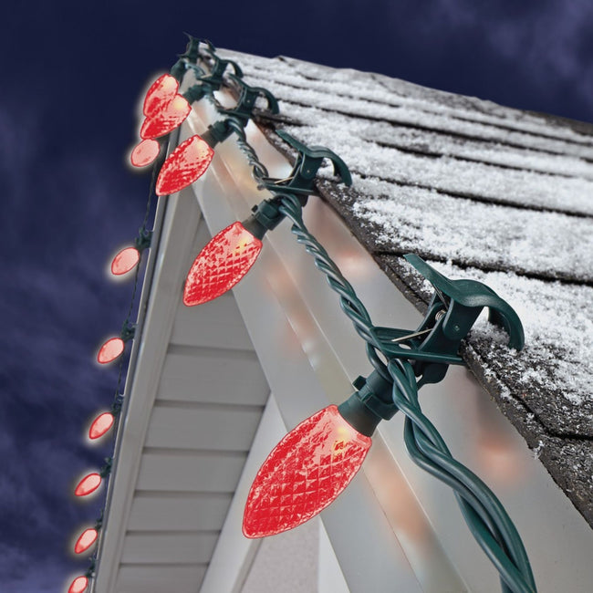 NOMA Red C9 Quick Clips - 25 Count, Attached to Roof on Blue Night Sky Background
