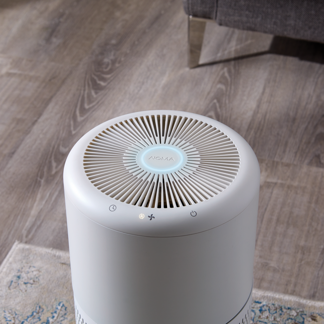 Aerial view of large air-purifier in a home environment - indicator ring blue