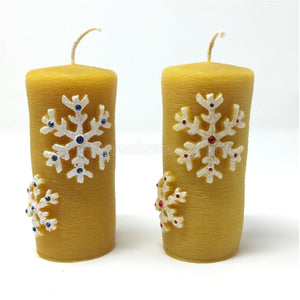 "All Natural Beeswax Pillar ""Christmas snowflakes"" candles made by the sisters of monasterevmc.org using 100% Canadian local beeswax / Bougies ""Flocons de Noël"" en cire d'abeille fabriquées par les soeurs du monasterevmc.org"