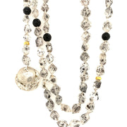 ELLEN HOFFMAN DESIGNS 18K GOLD AND STERLING SILVER ROCK CRYSTAL AND ONYX INFINITY LINK NECKLACE WITH ANTIQUE THAI FLOWER MONEY PENDANT