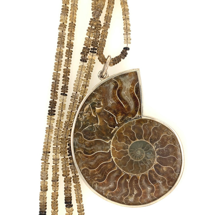 ELLEN HOFFMAN DESIGNS EXTRA-LARGE STERLING SILVER SLICED AMMONITE FOSSIL PENDANT ON QUARTZ NECKLACE