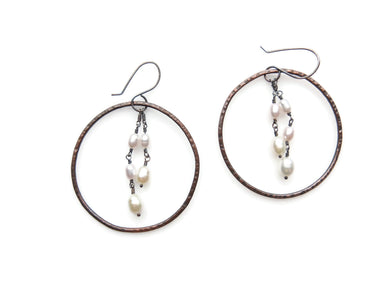 Dangle hoop earrings made from up-cycled copper, sterling silver and freshwater pearls.