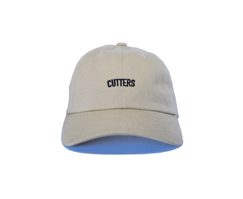 Our Rosewood Cutters khaki color dad hat with a low resolution embroidery.