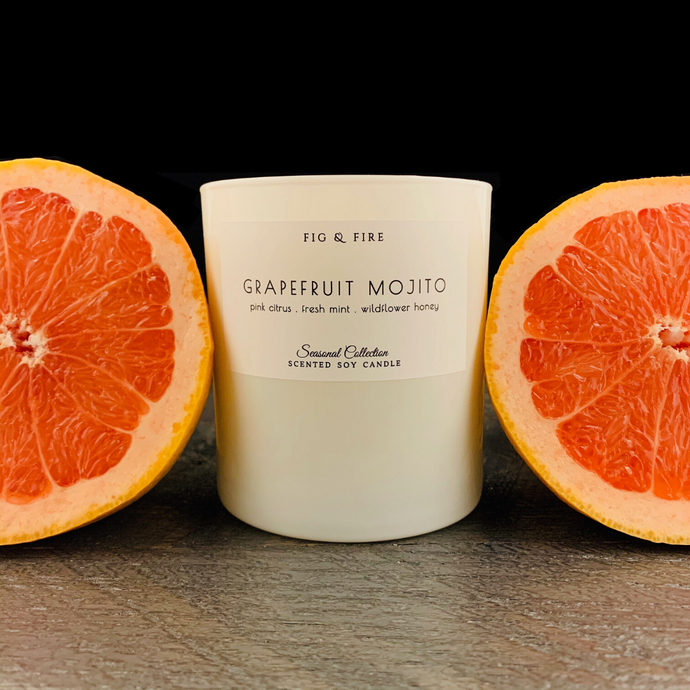 Handcrafted candle - scent is Grapefruit Mojito - smells of pink citrus, fresh mint, and wildflower honey - all natural soy candle - vegan, non-toxic, made with essential oils - container is a white tumbler