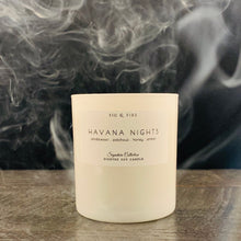 Load image into Gallery viewer, Handcrafted candle - scent Havana Nights - smells of sandalwood, patchouli, honey, and amber - all natural soy candle - vegan, non-toxic, made with essential oils - container is a white tumbler
