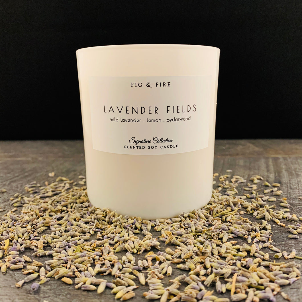 Handcrafted candle - scent is lavender fields - smells of wild lavender, lemon, cedarwood, and bergamot - all natural soy candle - vegan, non-toxic, made with essential oils - container is a white tumbler
