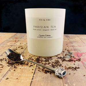 Handcrafted candle - scent is Parisian tea - smells of black currant, bergamot, and black tea - all natural soy candle - vegan, non-toxic, made with essential oils - container is a white tumbler