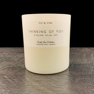 "All-natural, non-toxic, white tumbler candle with ""Thinking of you"" written on it. Underneath, it says ""On my mind, miss you, xoxo."" This candle can be any scent you want. Select your choice from the dropdown."