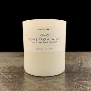 "All-natural, non-toxic, white tumbler candle with ""Love from afar"" written on it with three little hearts. Underneath, it says ""On my mind, miss you, xoxo."" This candle can be any scent you want. Select your choice from the dropdown."