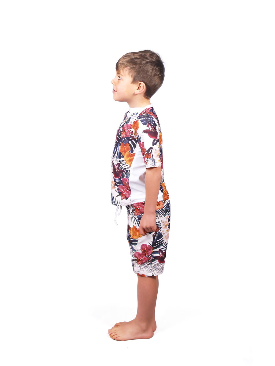 Ethical and sustainable swimwear for baby boy or toddler to tween, leafy print recycled ECONYL swim rashie ethically made in Australia.