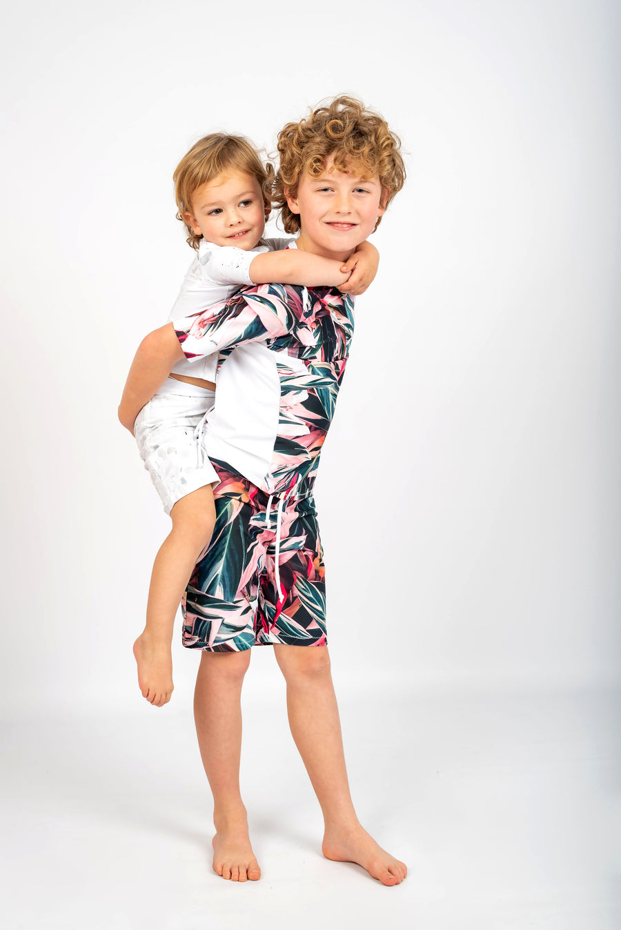 Ethical and sustainable swimwear for baby boy, toddler to tween boy, recycled ECONYL swim rashie made in Australia.