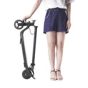 Girl standing with Joyor electric scooter H1