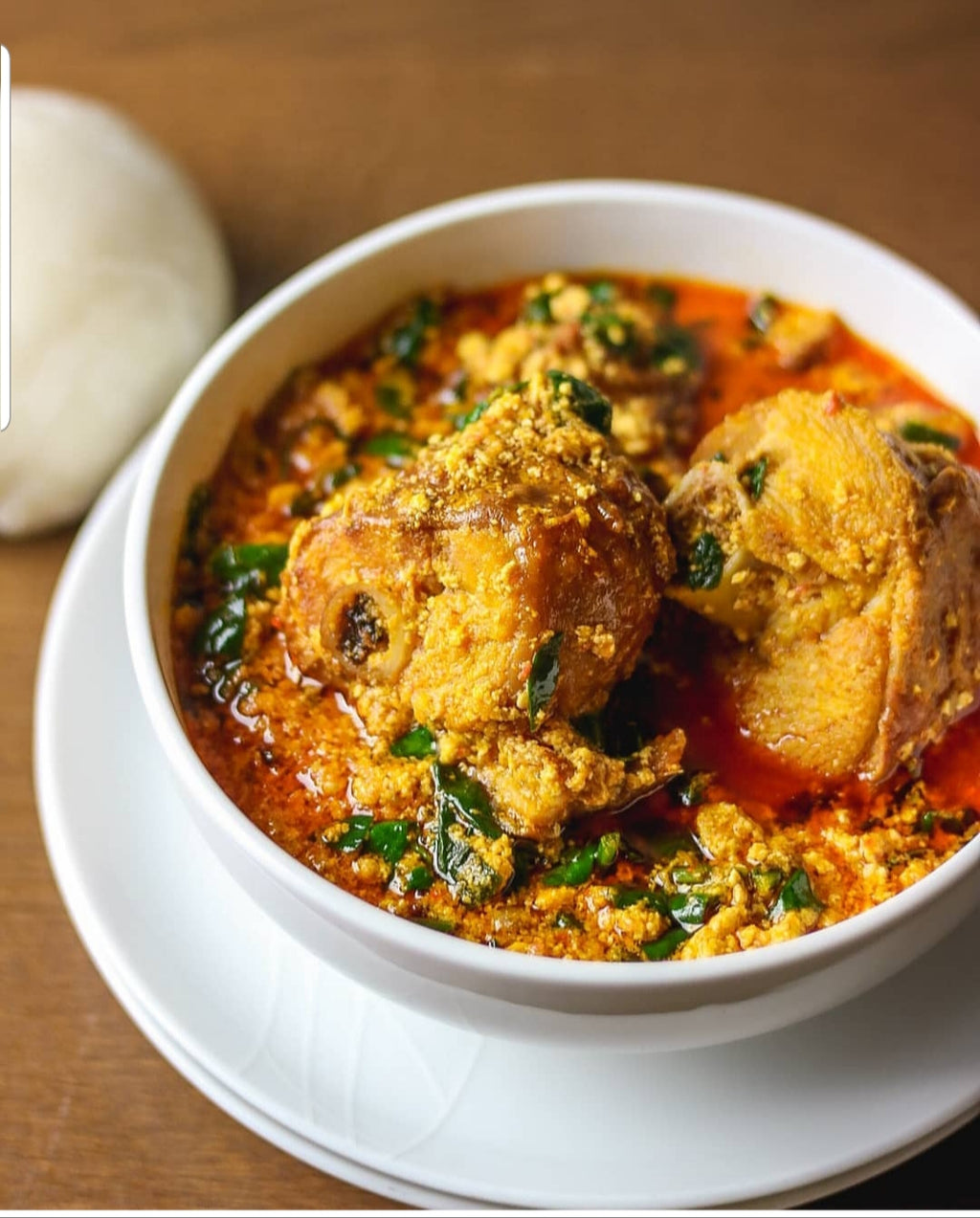 Egusi served with either Semolina, Pounded Yams or Nshima