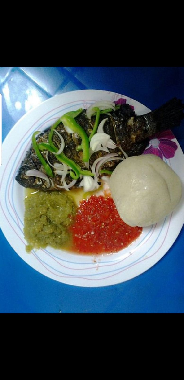 Banku (proportionate mixture of fermented corn and cassava  dough), Pepper & Fish