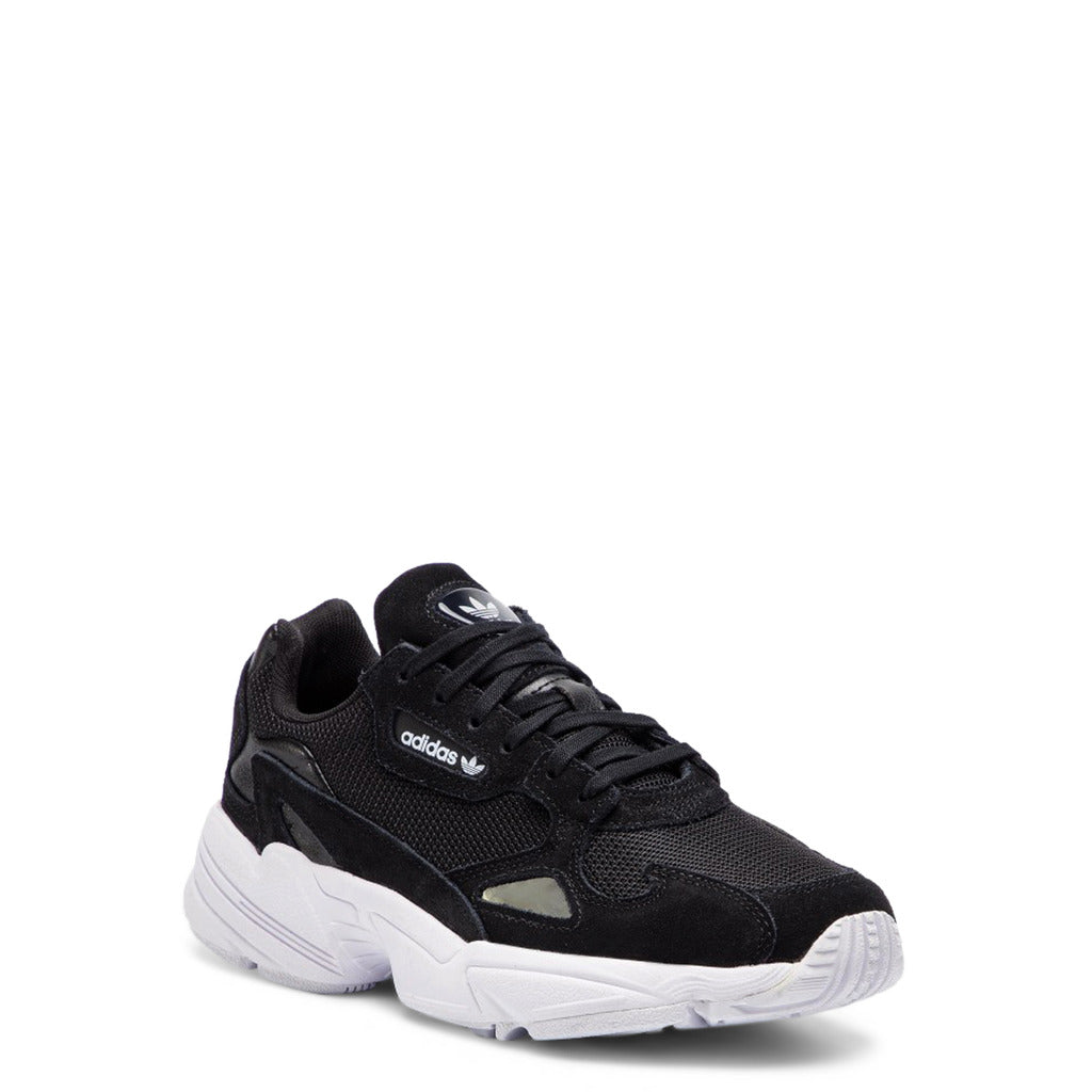 A black Adidas Originals Trainers Shoes with white rubber sole by the name Falcon