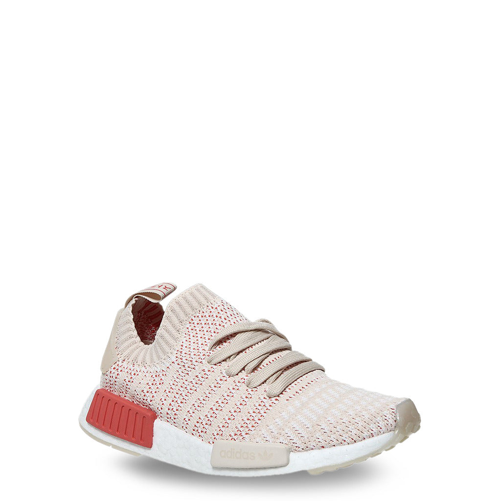 A beige Adidas Originals Trainers Shoes with knitted fabric and white rubber sole by the name NMD R1
