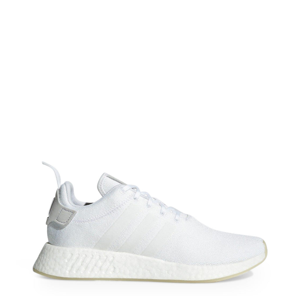 A white Adidas Originals Mens Footwear with knitted fabric and white stripes by the name NMD R2