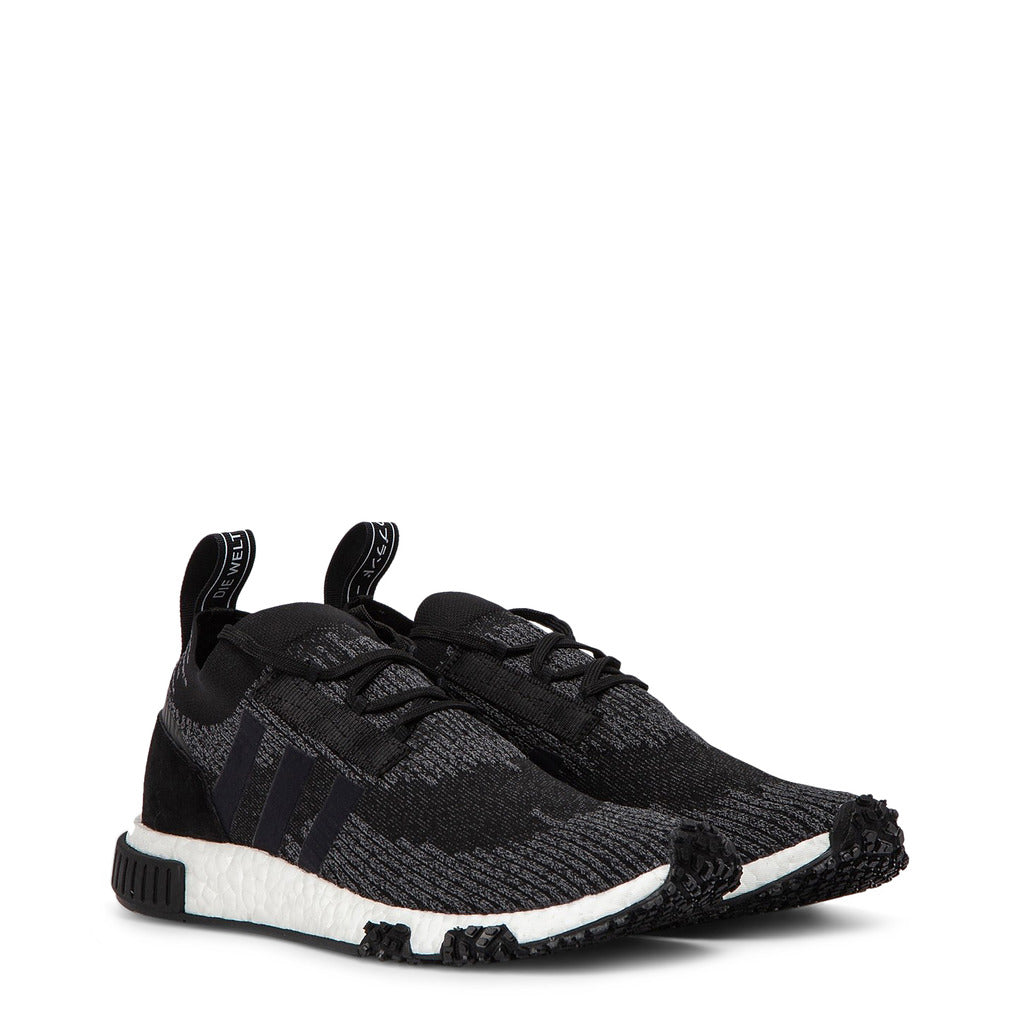 A black Adidas Originals Trainers Shoes with black stripes on the side and white sole rubber by the name NMD Racer