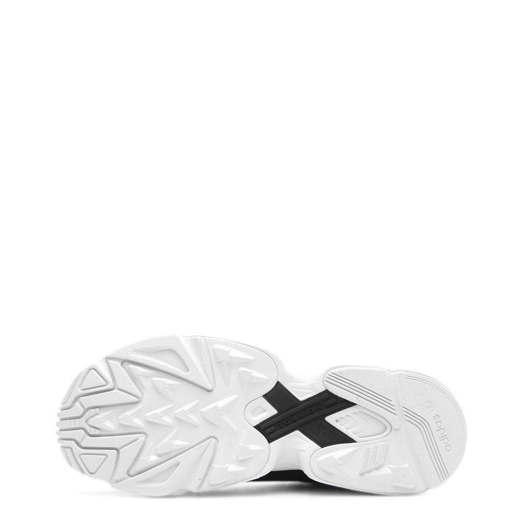White rubber sole with an black cross