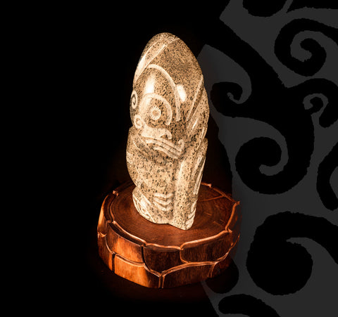 Tiki Sculpted in Stone on a Wooden Pedestal