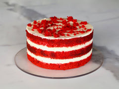 Naked red velvet cake layered with cream cheese frosting