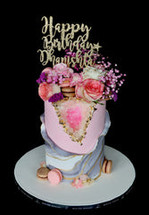 geode pink marble cake with macarons, gold and flowers