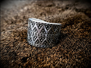 Viking Pewter Replica Ring on a sheep skin. This Jewellery has been designed from a Viking Age ring that was discovered in Birka, a Viking trading post.