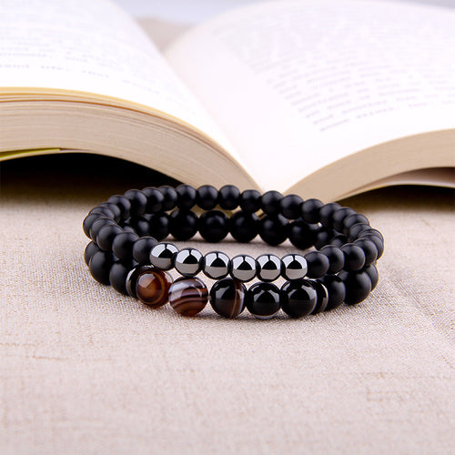 Natural stone bracelet with marble effect in front of an open book