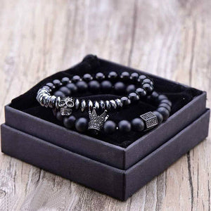 Two black onyx bracelets within their box