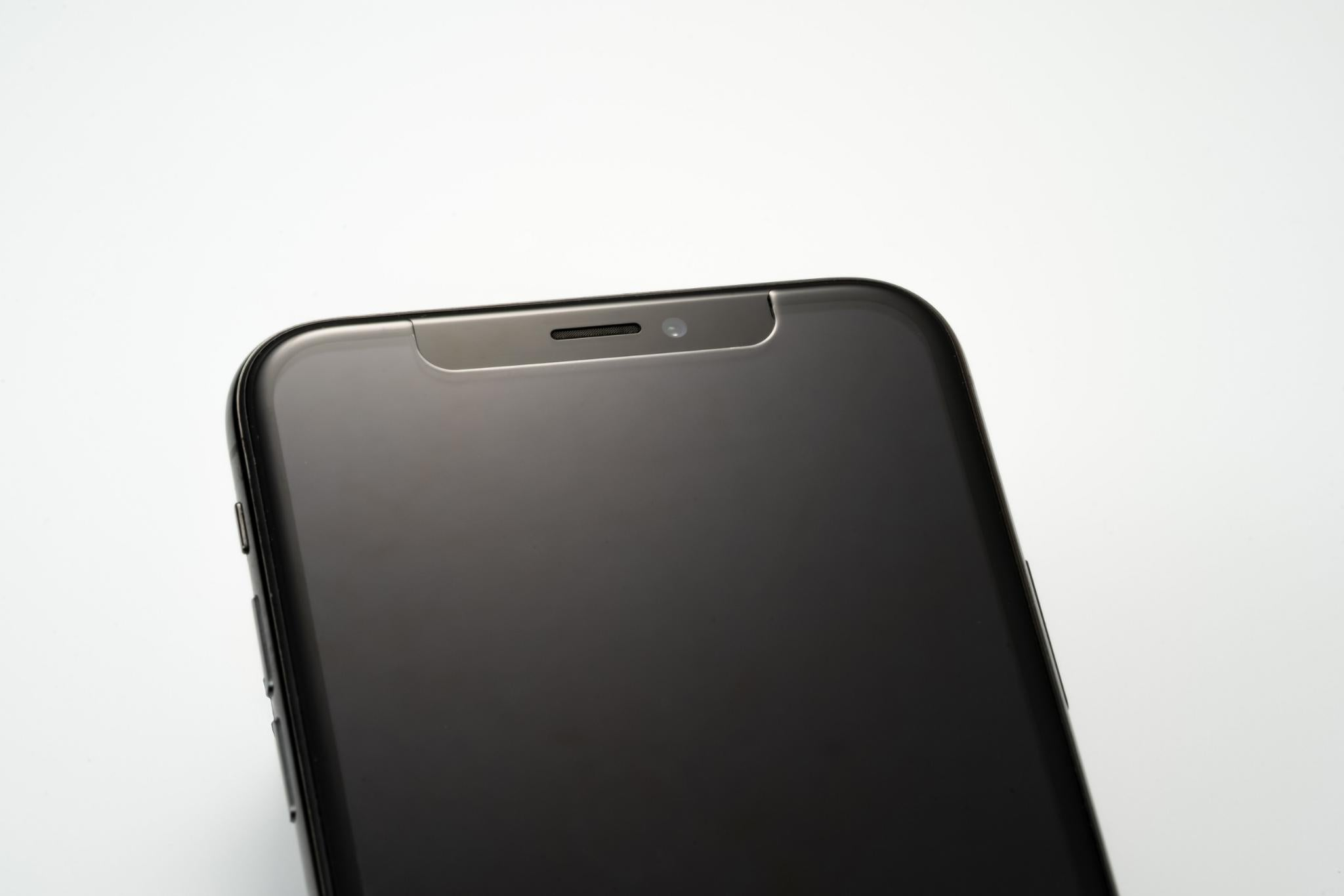Airo Glass iPhone screen protector close-up of corners with seamless edge-to-edge protection