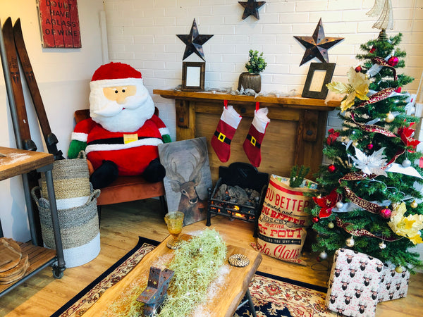 Puji The Store santa sat by the fire