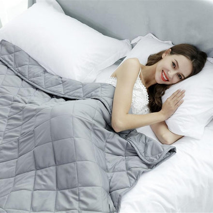 adult female modelling a weighted blanket for adults