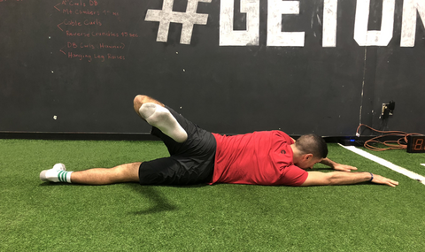 Beginning motion: bent knee and hip rotating across the body