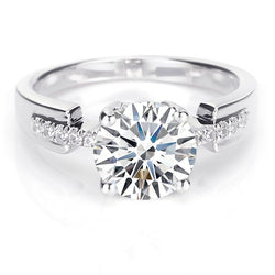 Four Prong Round Brilliant cut White Sapphire Engagement Ring