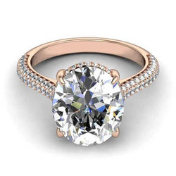 Oval cut white sapphire Rose Gold non traditional best engagement rings