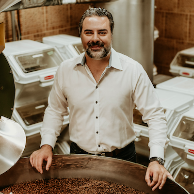 Image of Charles over roasted coffee beans