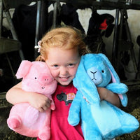 Baby girl taking her new friend Eleanor the cute blue stuffed bunny rabbit plush on a farm trip!