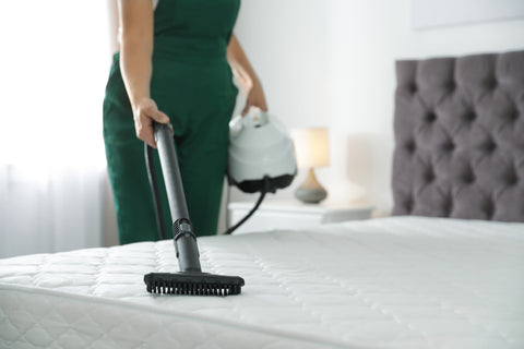 Vacuuming the mattress