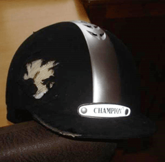 A damaged horse riding hat