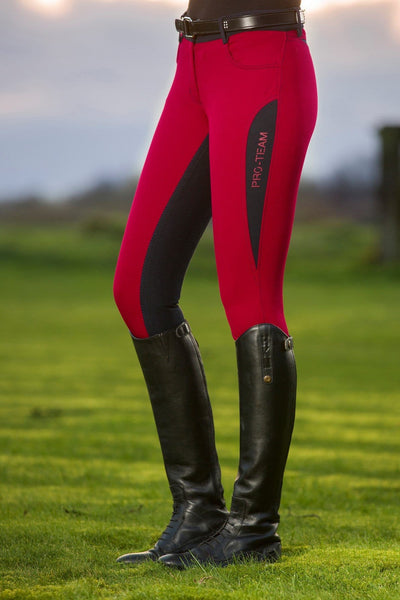 HKM Pro Team Dynamic Contrast Children's Three Quarter Seat Breeches worn by a Rider