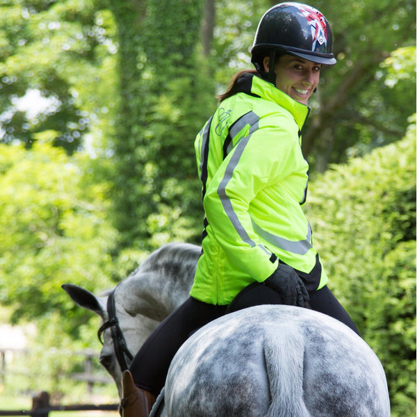 Equisafety Charlotte Dujardin Volte Waterproof Jacket Yellow Rear View on Horse Close Up 812488
