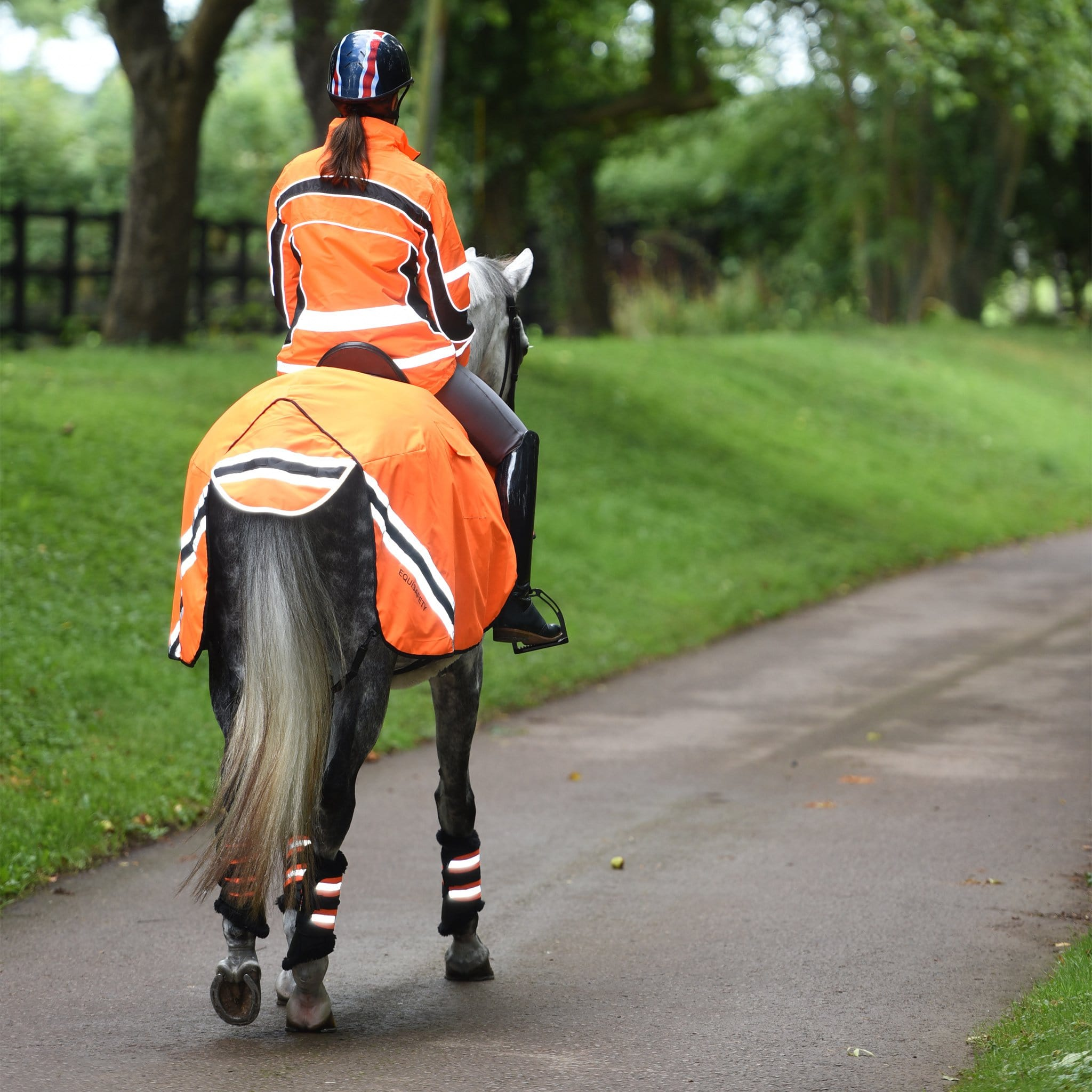 Equisafety Winter Wrap Around Sheet Orange Rear View With Rider WRUGO